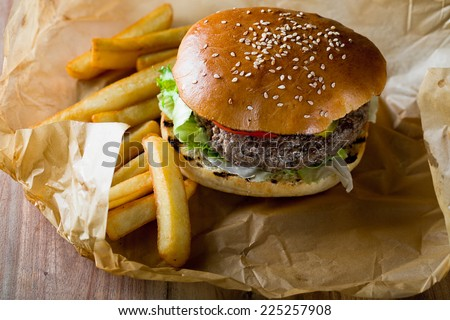 classic burger with chips - stock photo