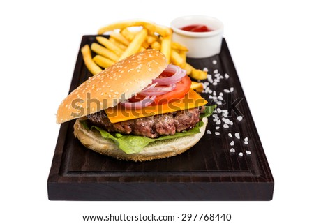 classic burger with juice meat cutlet serving with fry potato and ketchup on wooden board - stock photo
