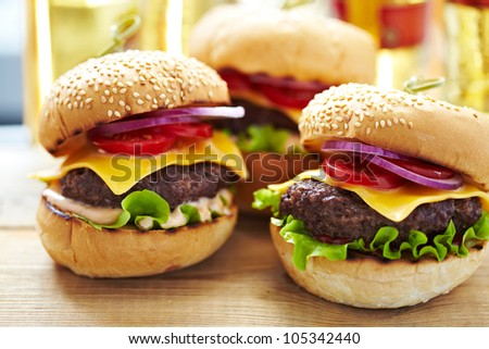 Classic Burgers with beer on background - stock photo