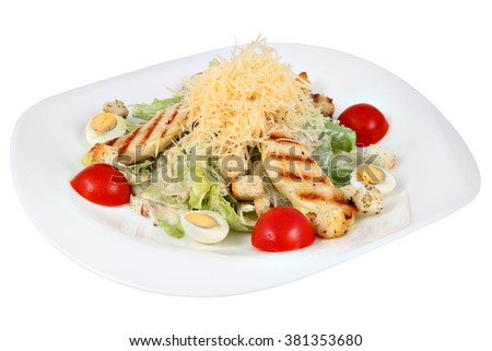 Classic Caesar salad with chicken and Lettuce, oval plate,  isolated on white background.