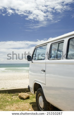 Classic camper van parked by the coast, Brazil - stock photo