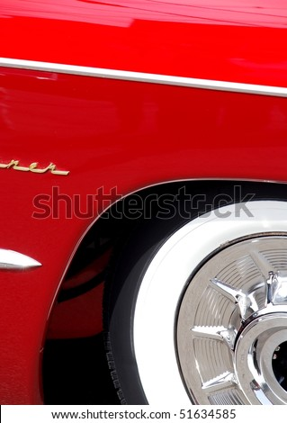 Classic candy apple red vintage car tire - stock photo