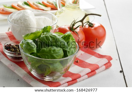 Classic caprese ingredients - mozzarella cheese tomatoes and basil