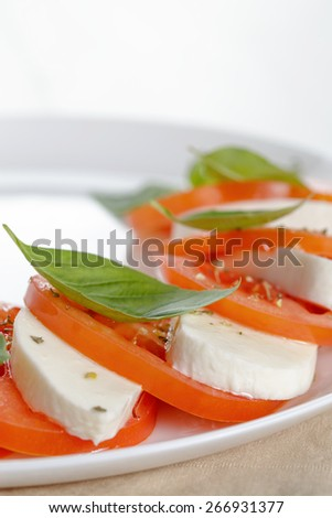 classic caprese salad on plate close up, selective focus