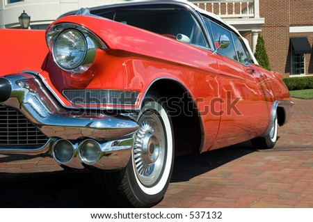 Classic car parked on brick paver's. - stock photo