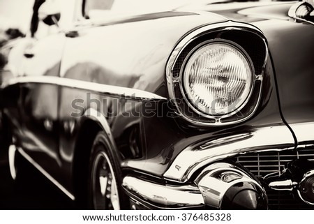 Classic car with close-up on headlights - stock photo