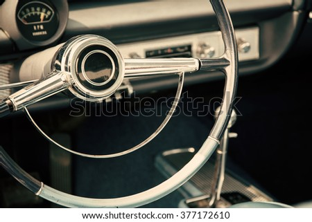 Classic car with close-up on steering wheel - stock photo