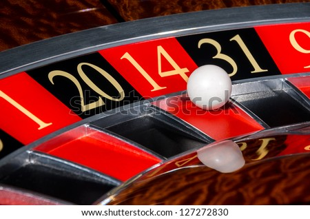 Classic casino roulette wheel with red sector fourteen 14 and white ball - stock photo