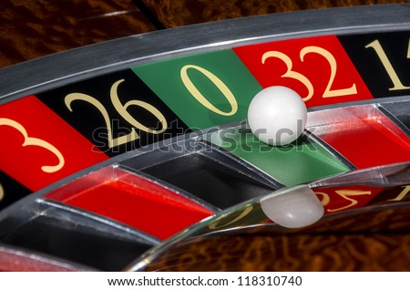 Classic casino roulette wheel with sector zero and white ball - stock photo