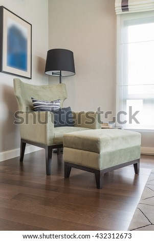 classic chair style on wooden floor with black lamp
