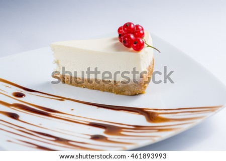 classic cheesecake with red currants on a white serving dishes