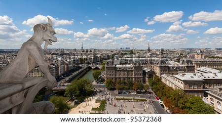 Classic chimera view of Paris from Notre Dame with Eiffel tower and Seine in the background - stock photo