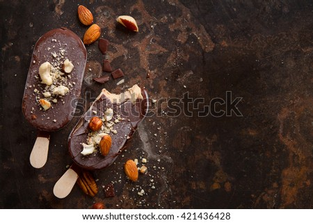 Classic chocolate ice cream with nuts on old background, selective focus - stock photo