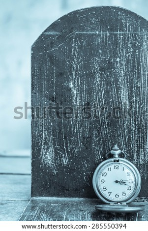 Classic clock on a black background. - stock photo
