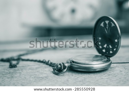 Classic clock on old wood - stock photo