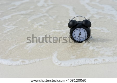 classic clock on the sand and sea - stock photo