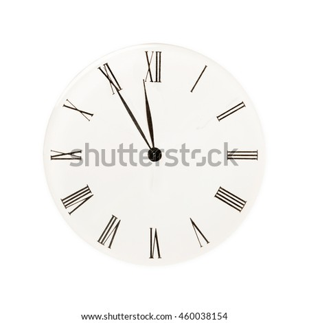 Classic clock showing five minutes to twelve, isolated on white background - stock photo