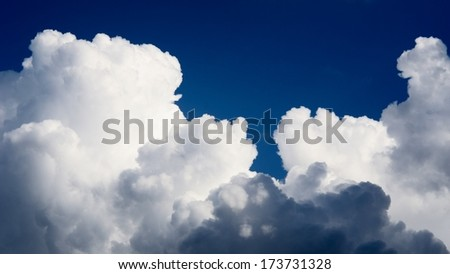 classic cloudscape. Blue sky with ornamental clouds - stock photo