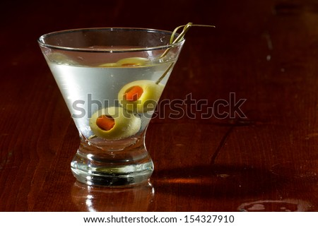 classic cocktail served with pimento stuffed cocktail olives - stock photo