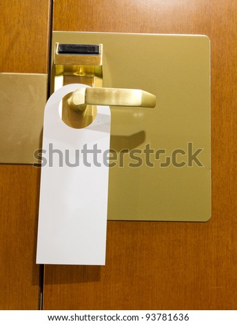 classic do not disturb sign on brass and wood hotel room door cleaned with copyspace for your text