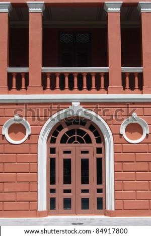 Classic door on pink building - stock photo