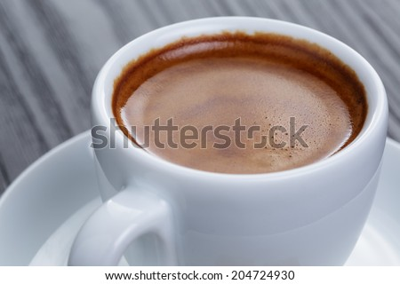 classic double espresso on wood table, close up - stock photo