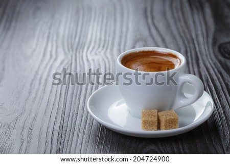 classic double espresso on wood table, with sugar cubes - stock photo