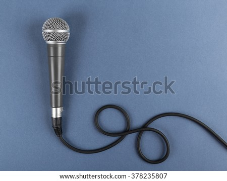 Classic dynamic microphone on a blue  background