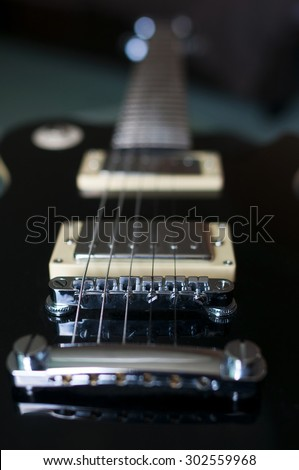 Classic electric guitar with string detail - stock photo
