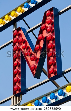 classic electric sign like the ones used in circus or old fashioned shops representing the M letter