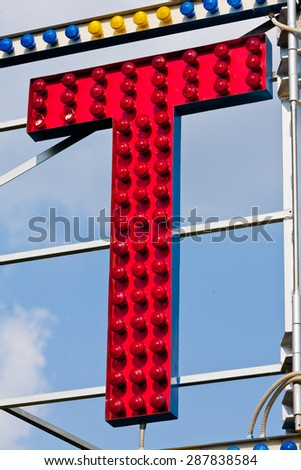 classic electric sign like the ones used in circus or old fashioned shops representing the T letter - stock photo