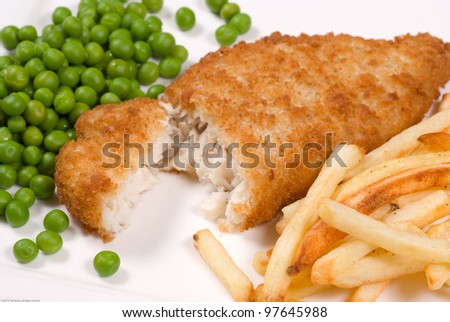 Classic English fish and chips served with peas - stock photo