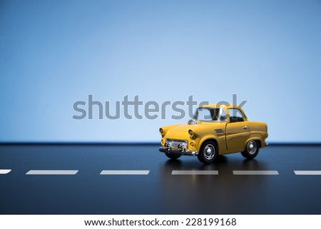 Classic fifties scale model toy car from front view. - stock photo