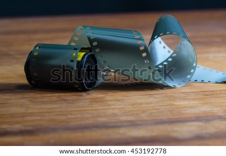 Classic film 35 mm on a wooden table - stock photo