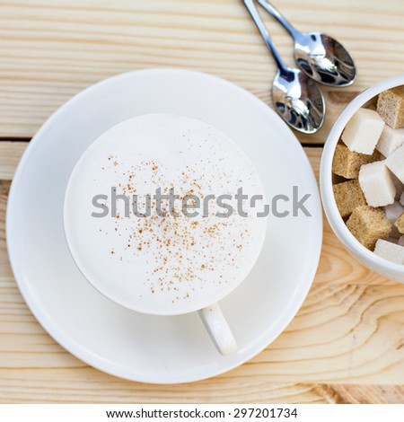 Classic foamy cappuccino in on a  wood table. Detail. From above. - stock photo