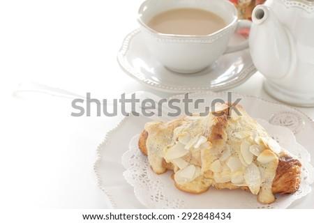 Classic French bakery, Croissants aux Amandes milk tea - stock photo