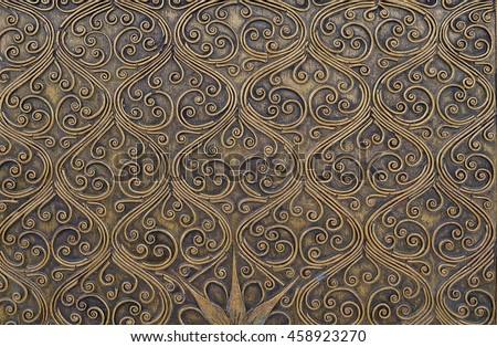 Classic gold metal pattern, Islamic Arabian Persia pattern. golden window closeup. wood - stock photo