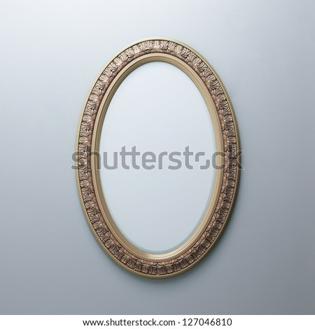 Classic Golden Carved Frame On White Wall (Oval Vertical Version) - stock photo