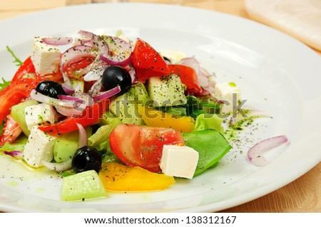 Classic greek salad on a dish in restaurant