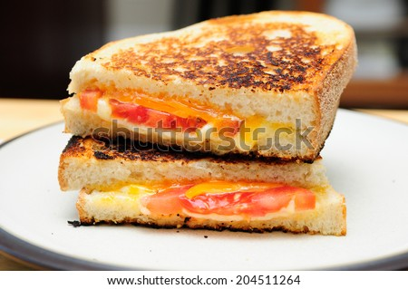 classic grilled cheese and tomato sandwiches - stock photo