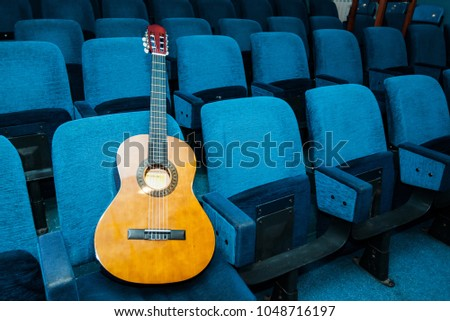 Classic guitar in empty conference room