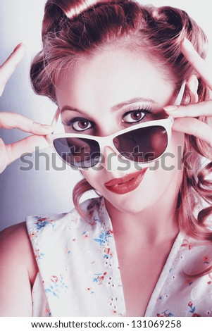 Classic Headshot Of A Retro American Fifties Pinup Girl Wearing Cute Face Fashion In Glamorous Style - stock photo