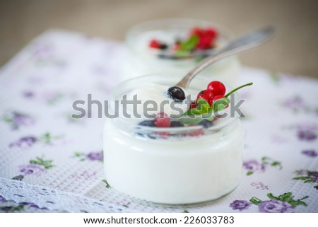 classic homemade yogurt in a glass jar with berries