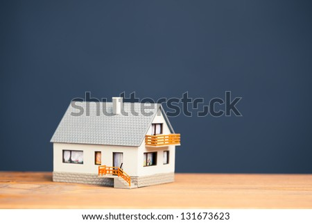 classic house model on blue with copy-space