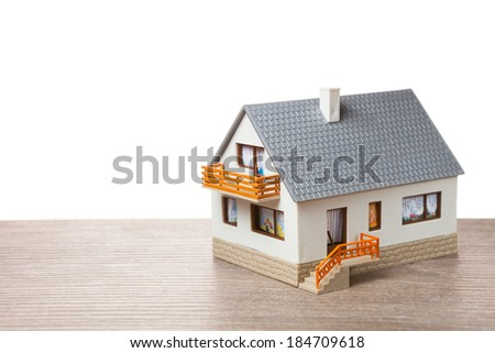 classic house model on wooden background - stock photo