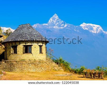 classic house near Himalayan mountains  (Sarangkot, Pokhara, Nepal) - stock photo