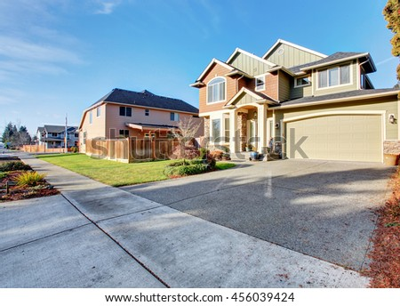 Classic house with garage, driveway, and grassy front yard. Curb appeal - stock photo