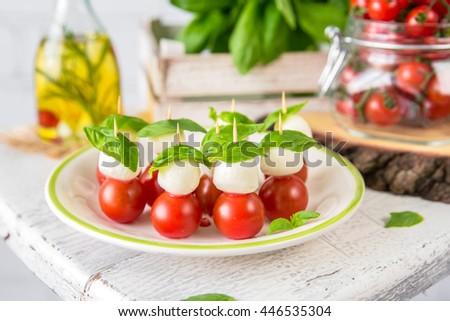 Classic Italian Caprese Canapes Salad With Tomatoes, Mozzarella di Buffala And Fresh Basil - stock photo