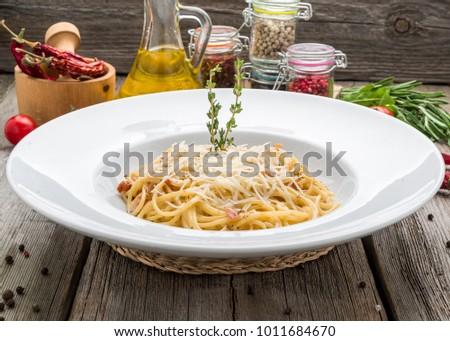 Classic Italian Cuisine Spaghetti Carbonara, on a wooden table