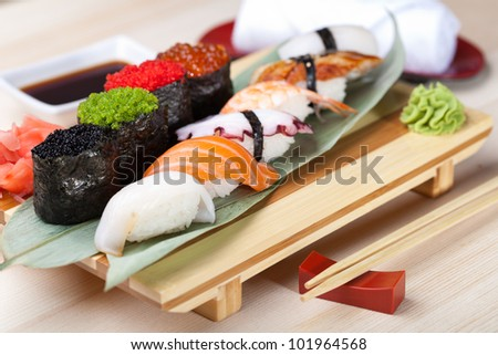 Classic japanese food- sushi on a plate - stock photo
